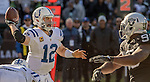 Indianapolis Colts quarterback Andrew Luck (12) passes ball under pressure on Saturday, December 24, 2016, at O.co Coliseum in Oakland, California.  The Raiders defeated the Colts 33-25.