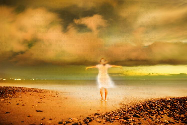 A female figure standing on a sea shore