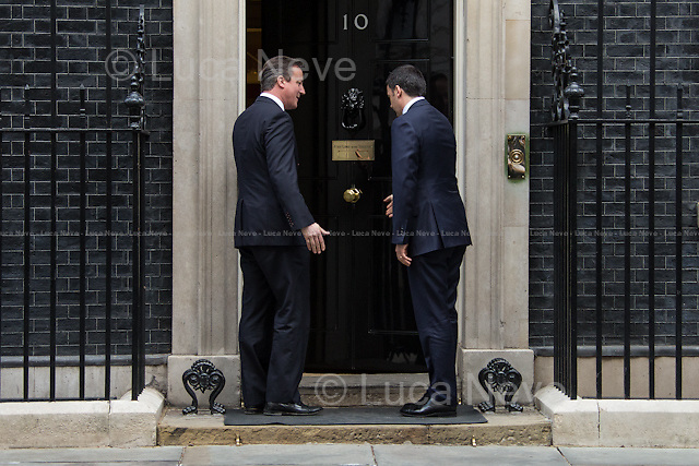 """London, 01/04/2014. The new Italian Prime Minister, Matteo Renzi, visited 10 Downing Street where he had a meeting with the British Prime Minister David Cameron. Noticeably, the Italian Prime Minister used a different car for his official visit in the UK. In fact, this time the official Maserati Quattroporte """"Ita 1"""", was replaced by a Chrysler 300c, car produced by the new FAC, Fiat Chrysler Automobiles, which moved its new holding company incorporated just yesterday from Italy (Historical base of FIAT - Fabbrica Italiana Automobili Torino) to the Netherlands, with tax domicile in the United Kingdom."""