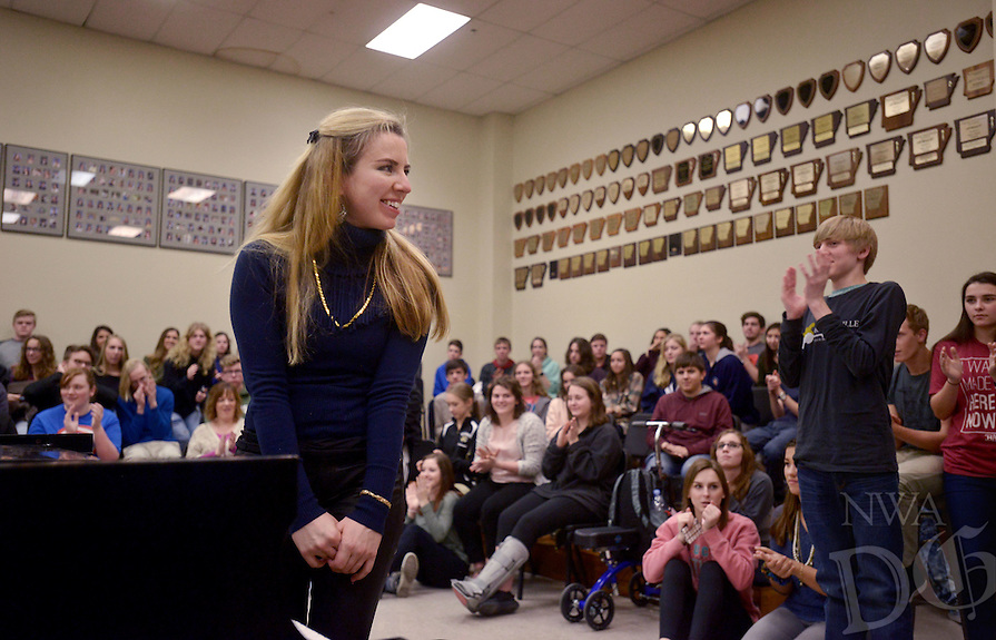 NWA Democrat-Gazette/BEN GOFF @NWABENGOFF<br /> Natasha Paremski, a pianist from New York, takes a bow after playing a Paganini piece for Bentonville High School music students on Friday Jan. 27, 2017 at the school. Paremski played several pieces before taking questions from students at the event, which was part of Symphony of Northwest Arkansas's ongoing community educational outreach. Paremski is in Northwest Arkansas to perform with the symphony at their Masterworks I: 'Momentum' concert at 7:30pm on Saturday at the Walton Arts Center in Fayetteville. Paremski was born in Moscow, Russia and began studying piano at age 4 before moving the United States and becoming a citizen at age 8.