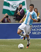 Argentina midfielder Fernando Gago (5) brings the ball forward. In an international friendly (Clash of Titans), Argentina defeated Brazil, 4-3, at MetLife Stadium on June 9, 2012.