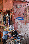 "SHOT 11/2/09 7:59:02 AM - Stopping in a back alley for a snack in Marrakech or Marrakesh, Morocco. Marrakech is known as the ""Red City"", is an important and former imperial city in Morocco. It has a population of 1,070,838 (as of 2004), and is the capital of the mid-southwestern economic region of Marrakech-Tensift-Al Haouz, near the foothills of the snow-capped Atlas Mountains. Like many North African and Middle Eastern cities, Marrakech comprises both an old fortified city (the médina) and an adjacent modern city (called Gueliz). Marrakech has the largest traditional market (souk) in Morocco and also has one of the busiest squares in Africa and the world, Djemaa el Fna.[2] The square bustles with acrobats, story-tellers, water sellers, dancers, and musicians. By night, the square turns into food stalls, becoming a huge open-air restaurant. Morocco, officially the Kingdom of Morocco is a country located in North Africa with a population of nearly 32 million people and an area just under 173,000 squrare miles.(Photo by Marc Piscotty / © 2009)"