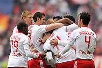 Thierry Henry (14) of the New York Red Bulls celebrates scoring with teammates . The New York Red Bulls defeated the Colorado Rapids 4-1 during a Major League Soccer (MLS) match at Red Bull Arena in Harrison, NJ, on March 25, 2012.