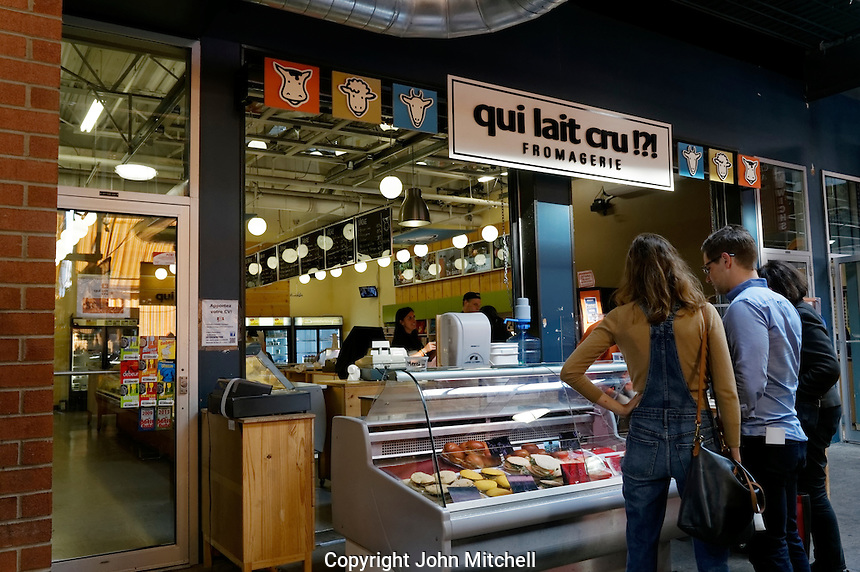 People at a cheese shop or fromagerie at the Jean Talon Market, Montreal, Quebec, Canada