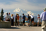 Mount McKinley, or Denali, is shown with tourists from a viewpoint off of the Parks Highway, just south of the mountain.