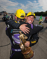 Sep 25, 2016; Madison, IL, USA; NHRA pro stock driver Alex Laughlin (right) and funny car driver Jack Beckman celebrate after winning the Midwest Nationals at Gateway Motorsports Park. Mandatory Credit: Mark J. Rebilas-USA TODAY Sports
