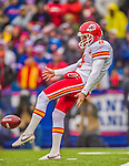 9 November 2014: Kansas City Chiefs punter Dustin Colquitt kicks to the Buffalo Bills in the first quarter at Ralph Wilson Stadium in Orchard Park, NY. The Chiefs rallied with two fourth quarter touchdowns to defeat the Bills 17-13. Mandatory Credit: Ed Wolfstein Photo *** RAW (NEF) Image File Available ***