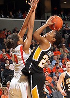 Dec. 18, 2010; Charlottesville, VA, USA; UMBC Retrievers guard Kristin Coles (22) shoots the ball in front of Virginia Cavaliers center Simone Egwu (4) during the game at the John Paul Jones Arena.  Mandatory Credit: Andrew Shurtleff