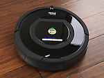 iRobot Roomba 770 household vacuum cleaning robot on hardwood floor