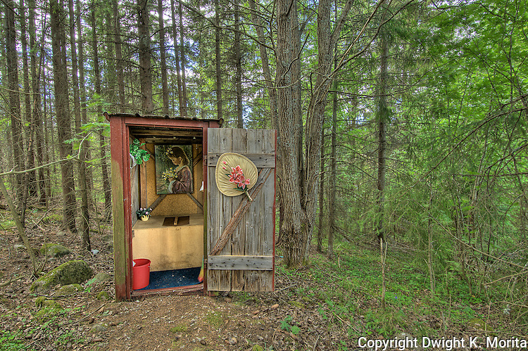 An example of a decorated outhouse waits in the woods of Fallesvikshamn nea Nordingra on the Baltic coast.