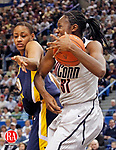 Hartford, CT-10, March 2010-030910CM05 UCONN's Tina Charles pulls a rebound away from West Virginia's Asya Bussie, at the XL Center in Hartford Tuesday night.  Charles scored 10 points to help lead the  Huskies past West Virginia 60-32 to win the Big East Championship.           --Christopher Massa Republican-American