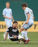 Cristian Castillo #12 of D.C. United slides into Wells Thompson #15 of the Colorado Rapids during an MLS match on May 15 2010, at RFK Stadium in Washington D.C. Colorado won 1-0.