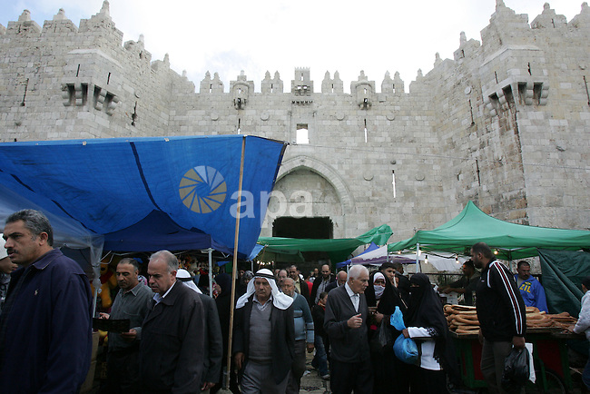 """Palestinians shop in front of the Damascus gate in Jerusalem's old city on Nov. 4,2011, ahead of the Muslim Eid al-Adha festival at the end of the week. Muslims across the world are preparing to celebrate the annual """"Festival of Sacrifice"""", which marks the end of the Hajj pilgrimage to Mecca and in commemoration of Prophet Abraham's readiness to sacrifice his son to show obedience to God. Photo by Mahfouz Abu Turk"""