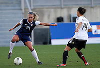 US's Whitney Engen fights for the ball with Germany's Dzsenifer Marozsan during their Algarve Women's Cup soccer match at Algarve stadium in Faro, March 13, 2013.  .Paulo Cordeiro/ISI