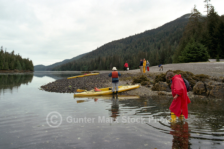Haida Gwaii (Queen Charlotte Islands), Northern BC, British Columbia, Canada - Eco Tourists exploring Burnaby Narrows, Gwaii Haanas National Park Reserve and Haida Heritage Site - Model Released Person in foreground