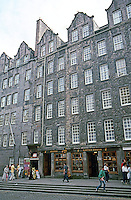 Edinburgh: Tenements (blocks of apartments) , Old City. Either Castlehill or Lawnmarket  (same street). Shops on 1st floor. Photo '87.