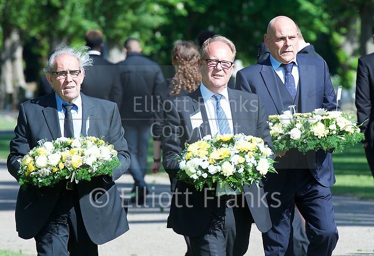 Leslie Rhodes funeral at North East Surrey Crematorium, Morden, Surrey, Great Britain 5th May 2017 <br /> <br /> Friends bringing wreaths to the funeral <br /> <br /> Leslie Rhodes was one of the victims of the Westminster terror attack on 22nd March 2017. Mr Rhodes was Winston Churchill's former window cleaner.<br /> <br /> Leslie Rhodes, from south London, suffered serious injuries when terrorist Khalid Masood mowed down pedestrians on Westminster Bridge. The 75-year-old was rushed to King&rsquo;s College Hospital but died there when his life support was withdrawn at about 8.25pm the following day. <br /> <br /> He had been attending an appointment at St Thomas&rsquo;s Hospital before Masood went on a rampage &ndash; killing four and injuring 50 before he was shot dead by police.<br /> <br /> Mr Rhodes, who friends revealed was the former window cleaner of Winston Churchill, suffered broken ribs and a punctured lung in the attack.<br /> <br /> <br /> Photograph by Elliott Franks <br /> Image licensed to Elliott Franks Photography Services