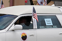 Phoenix, Arizona. July 7, 2013 - Nineteen hearses for each of the fallen members of the Granite Mountain Hotshots Arizona firefighting crew who died last week formed a procession to honor them in Phoenix as their bodies were taken back home to Prescott, about an 80-mile route. The remains of Travis Carter are inside this hearse that makes it way toward downtown Phoenix and then the city of Prescott. Photo by Eduardo Barraza © 2013