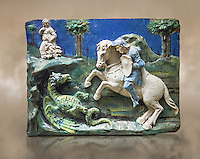 Enamelled terracotta relief panel of Saint George sleighing the Dragon. Made in Florence around 1520. Inv RF 3096, The Louvre Museum, Paris.