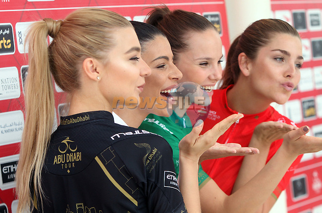Podium girls wear the jerseys at sign on before the start of Stage 1 Emirates Motor Company Stage of the 2017 Abu Dhabi Tour, running 189km from Madinat Zayed through the desert and back to Madinat Zayed, Abu Dhabi. 23rd February 2017<br /> Picture: ANSA/Matteo Bazzi | Newsfile<br /> <br /> <br /> All photos usage must carry mandatory copyright credit (&copy; Newsfile | ANSA)