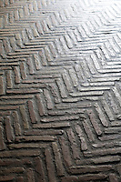 Ridged flooring in a herringbone pattern