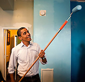 Washington, DC - January 19, 2009 -- United States President-elect Barack Obama paints walls at the Sasha Bruce House in Washington, D.C., U.S., Monday, January 19, 2009.  The Sasha Bruce House aids at risk youths in the Washington, D.C. ..Credit: Joshua Roberts - Pool via CNP