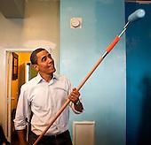 Washington, DC - January 19, 2009 -- United States President-elect Barack Obama paints walls at the Sasha Bruce House in Washington, D.C., U.S., Monday, January 19, 2009.  The Sasha Bruce House aids at risk youths in the Washington, D.C. ..Credit: Joshua Roberts - Pool via CNP