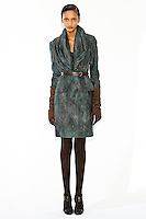 Model wears a draped collar jacket, sleeveless prism-cut sheath dress, and skinny belt, by Fiona Cibani, for the Ports 1961 Pre-Fall 2011 L'heure bleue collection, December 8, 2010.