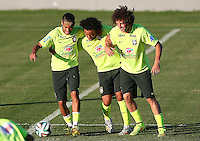 Neymar, Marcelo and David Luiz of Brazil joke around during training ahead of tomorrow's World Cup quarter final vs Colombia