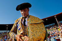 A Spanish bullfighter enters into the bullring in Torremolinos, Spain, 28 July 2006.