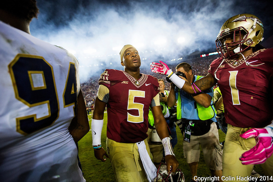 TALLAHASSEE, FLA. 10/18/14-FSU-ND101814CH-Florida State quarterback Jameis Winston, center, walks off the field after the Seminoles beat the Fighting Irish 31-27 Saturday at Doak Campbell Stadium in Tallahassee.<br /> COLIN HACKLEY PHOTO