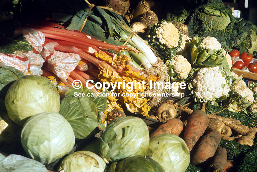 Vegetable display, greengrocer, Belfast, N Ireland, UK, cabbage, carrots, cauliflowers, leaks, tomatoes, parsnips, rhubarb, 197602130125VD..Copyright Image from Victor Patterson, 54 Dorchester Park, Belfast, UK, BT9 6RJ..Tel: +44 28 9066 1296.Mob: +44 7802 353836.Voicemail +44 20 8816 7153.Skype: victorpattersonbelfast.Email: victorpatterson@me.com.Email: victorpatterson@ireland.com (back-up)..IMPORTANT: If you wish to use this image or any other of my images please go to www.victorpatterson.com and click on the Terms & Conditions. Then contact me by email or phone with the reference number(s) of the image(s) concerned.