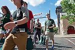 A group of incoming freshman walk down Court Street after redeeming a free t-shirt coupon at Universitees T-Shirt Shop during Bobcat Student Orientation 2016. © Ohio University / Photo by Kaitlin Owens