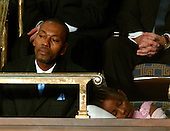 Washington, D.C. - January 23, 2007 -- Wesley Autrey, the 50 year-old construction worker who won the Bronze Medallion for saving a man who had fallen in a New York City subway station, left, watches as United States President George W. Bush delivers his State of the Union Address to a joint session of the United States Congress at the Capitol in Washington, D.C. on January 23, 2007 while his daughter Shuqui, right, sleeps. .Credit: Ron Sachs / CNP