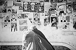 Women in burqa, passing election posters (Kabul, Afghanistan, 2005).