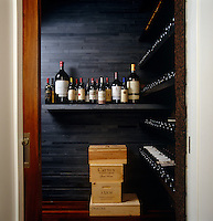 The temperature-controlled wine cellar is lined with slate and Portugese cork