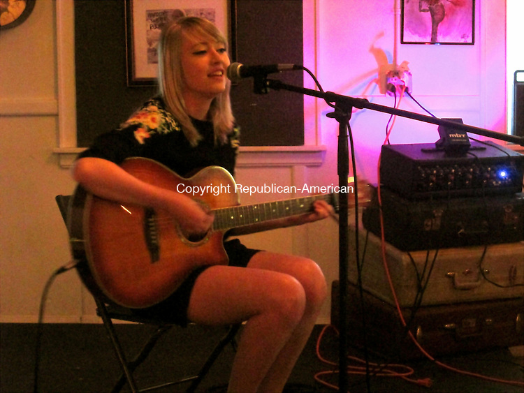 OAKVILLE,CT- 11 June 2015- 061115DL01-- Maia Dobbs, 19, solo guitar player and singer of Woodbury, CT, performs at a Seagreen Records show at Hardcore Sweet Cupcakes in Oakville. Dobbs will be releasing her album, Fire, on Facebook next month. Destiny Lopez Republican-American