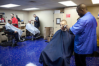SH3 (SW) Kellen Saunders, right, cuts the hair of Lieutenant John Konst on board the USNS Comfort, a naval hospital ship, before its mission to help survivors of the earthquake in Haiti on Tuesday, January 19, 2010.