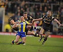 Rugby League-Warrington Wolves v Castleford Tigers-Super League-Halliwell Jones Stadium-03/01/2012-Pictures by Paul Currie-Keep-Micky Higham is tackled
