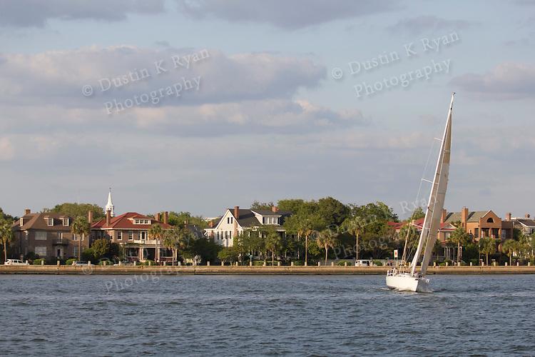 Sailboat Sugar Magnolia J-120 sailing on the Charleston Harbor and battery near the cooper river bridge