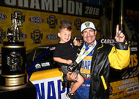 Nov 12, 2016; Pomona, CA, USA; NHRA funny car driver Ron Capps celebrates with Caden Langdon after clinching the 2016 funny car world championship during qualifying for the Auto Club Finals at Auto Club Raceway at Pomona. Mandatory Credit: Mark J. Rebilas-USA TODAY Sports