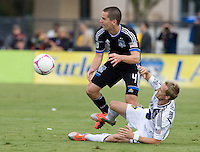 Sam Cronin of Earthquakes controls the ball away from Christian Wilhelmsson of Galaxy at Buck Shaw Stadium in Santa Clara, California on October 21st, 2012.  San Jose Earthquakes and Los Angeles Galaxy tied at 2-2.