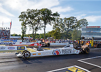 Jun 10, 2016; Englishtown, NJ, USA; NHRA top fuel driver Antron Brown (near) races alongside Doug Kalitta during qualifying for the Summernationals at Old Bridge Township Raceway Park. Mandatory Credit: Mark J. Rebilas-USA TODAY Sports