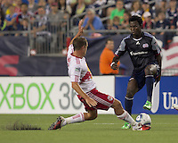 New England Revolution forward Kenny Mansally (7) loses ball to New York Red Bull slide tackle. In a Major League Soccer (MLS) match, the New England Revolution tied New York Red Bulls, 2-2, at Gillette Stadium on August 20, 2011.