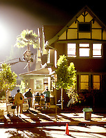 Stock photo showing a Film Production Crew working on Location at a Home at night.