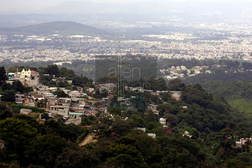 Pilar Lopez, coordinator of the Guatemalan non-governmental organization Medicos Sin Fronteras, said she believes there to be about 3,000 children and young adults living on the streets of Guatemala City, partially shown here from an overlook in the surrounding mountains<br />