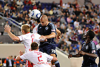 Aurelien Collin (78) of Sporting Kansas City heads the ball. The New York Red Bulls defeated Sporting Kansas City 1-0 during a Major League Soccer (MLS) match at Red Bull Arena in Harrison, NJ, on April 30, 2011.