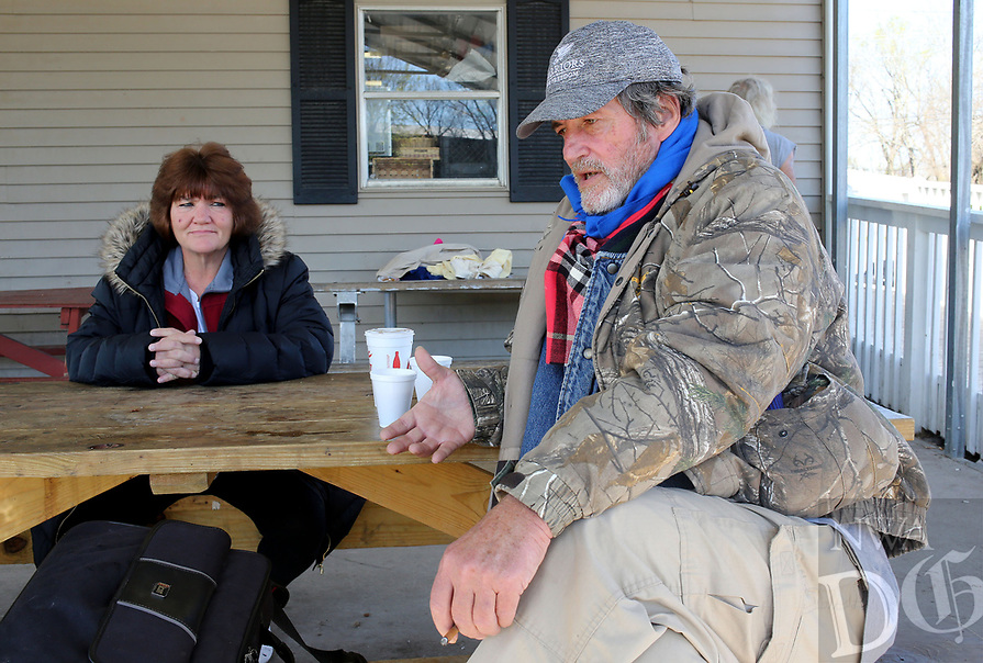 NWA Democrat-Gazette/DAVID GOTTSCHALK  Stephanie Regan (left), listens to  Alvin Davis, both residents of the Walker Family Residential Community, Thursday, April 6, 2017, at the 7 Hills Homeless Center speak about the creation of the Independent Workshop, Homeless Workshop, in Fayetteville. Regan would be a foreman at the shop that would manufacture, produce and sell items by the homeless. The shop is in it's planning stages and would help individuals become self sufficient by gaining marketable skills.