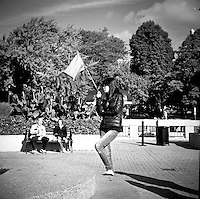 Bussed tourists from all over the world quickly follow tour guides who rush them from one spot to another for a quick look and photo. Then meet back at the flag and head off to the next location. Ricoflex TLR. 2014
