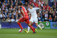 Cardiff City Stadium, Cardiff, South Wales - Tuesday 12th Aug 2014 - UEFA Super Cup Final - Real Madrid v Sevilla - <br /> <br /> Real Madrid&rsquo;s Gareth Bale(c) breaks through the Sevilla defence. <br /> <br /> <br /> <br /> Photo by Jeff Thomas/Jeff Thomas Photography